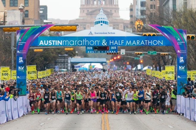 Runners leave the starting line for the 2020 Austin Marathon, Half Marathon and 5K in downtown August. That was the last major live running event in Austin. This year's Half Marathon's field has been cut by 50% because of pandemic precautions.