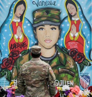 First Lieutenant Spencer Daulisa pays his respects to a memorial of Spc. Vanessa Guillen outside of Fort Hood military base in Killeen on Thursday, July 24, 2020.