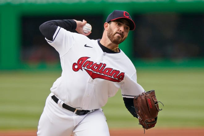 Cleveland starting pitcher Aaron Civale delivers in the first inning of a baseball game against the New York Yankees, Thursday, April 22, 2021, in Cleveland. [Tony Dejak/Associated Press]