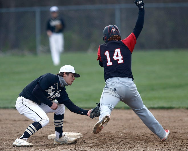 South Central shortstop Sam Seidel (2) tags out Crestview's Josh Myers (14) during high school baseball action on April 22. Seidel was named the 2021 Firelands Conference Player of the Year in baseball.