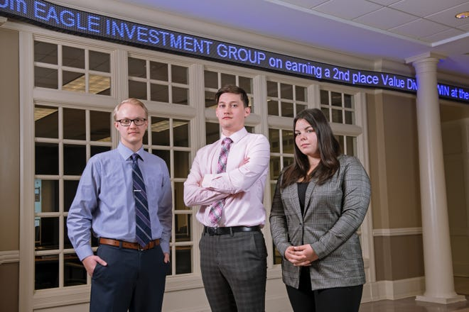 Members of the Eagle Investment Group who competed in the Quinnipiac Global Portfolio competition's Undergraduate Value Division included, from left, Justin Stritmatter, Jacob Boerner and Jessica Kritschil. Not pictured is EIG member Jacob Koehler.