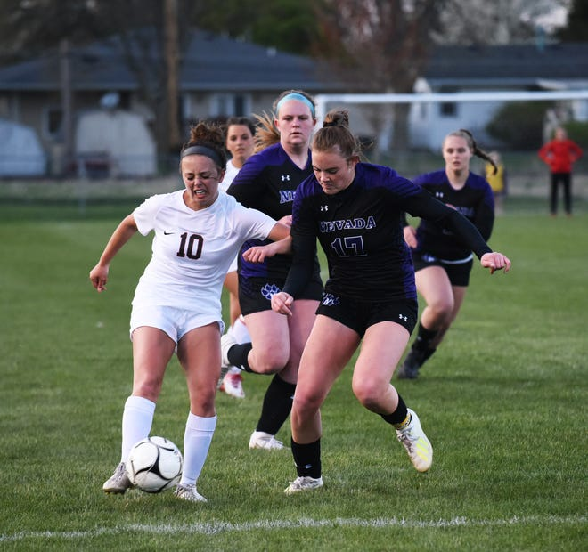 Gilbert's Sydney Lynch tries to get by Nevada's Hannah Thomsen on her way to the goal during the first half of the No. 3 (1A) Tigers' 1-0 victory over No. 9 Nevada Thursday at the SCORE Athletic Complex in Nevada. Lynch scored the game's only goal.