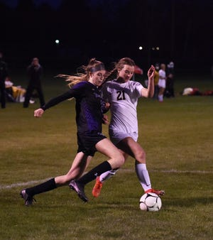 Nevada's Isabelle Nelson makes her way toward the goal against tight defense by Gilbert's Keara O'Brien during the final minutes of the Cubs' 1-0 loss to the Tigers April 22 at the SCORE Athletic Complex in Nevada.