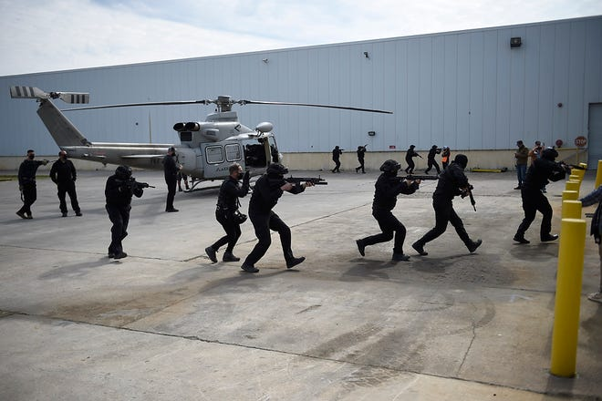 """Actors portraying commandos rehearsed a scene for the movie """"Agent Game,"""" which was being filmed in Evans in April."""
