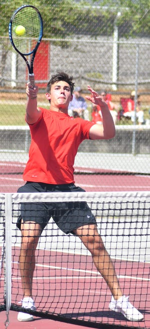 Gamecock Austin Markovcic returns a shot at the net against Johnson County on April 21 with playing with Screven County doubles partner Zach Thompson.