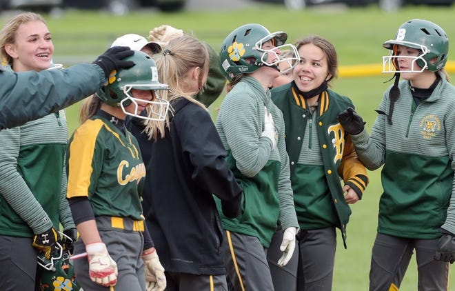 The Blackhawk Cougars surround teammate Ashley Dickton (center) after she drove in the tying and winning runs against Central Valley during Thursday's game at Blackhawk High School.