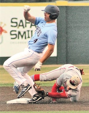 Bartlesville High School baserunner Braeden Winters, left, was ruled safe on this close play at third during Thursday's varsity baseball battle against Bixby High.