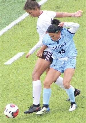 Yhanna Osborn, right, of the Bartlesville High girls soccer team takes on a bigger defender during recent home action.