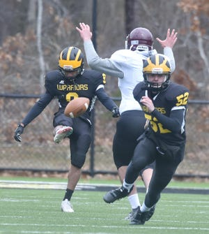 Anthony Lovati launches a punt for Nauset in a 20-14 victory over Falmouth on Senior Night last week.