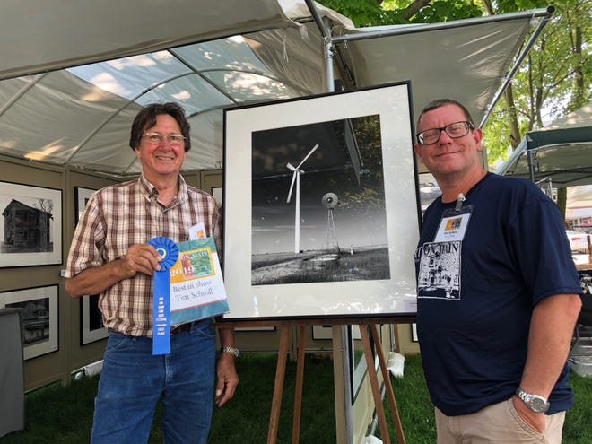 Tim Schroll, Blandsville, left, received Best in Show honors for his photography at the Seventh Annual Art on Main Fine Arts Festival, June 1-2 in Jones Park 2019 in Canton. Also pictured is co-chair Eric Duffield.