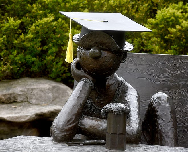 Beetle Bailey sports a mortar board ahead of graduations at the University of Missouri.