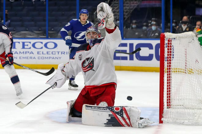 Elvis Merzlikins gives up a goal on a shot by Tampa Bay Lightning forward Blake Coleman in the the second period Thursday at Amalie Arena in Tampa. The Lightning won 3-1 to push the Blue Jackets' winless skid to eight in a row.
