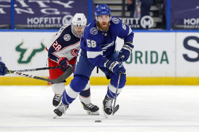 David Savard brings the puck up past former teammate Oliver Bjorkstrand in the second period of the Tampa Bay Lightning's 3-1 victory Thursday night at Amalie Arena in Tampa, Fla.