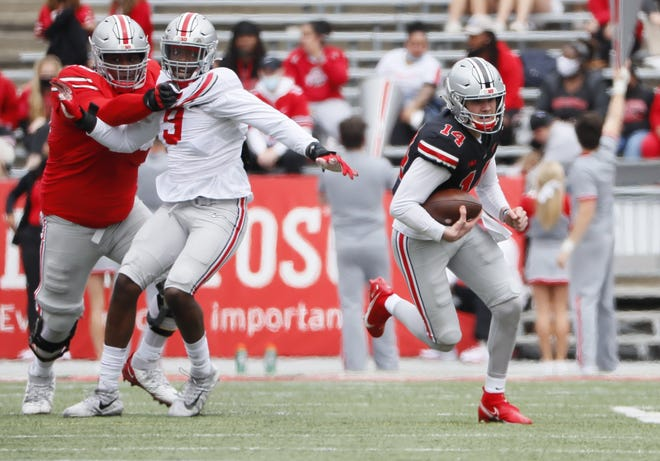 """Quarterback Kyle McCord  scrambles in the Ohio State spring game on April 17. Offensive coordinator Kevin Wilson said starting quarterback candidates McCord, C.J. Stroud and Jack Miller """"actually move better than most people think."""""""