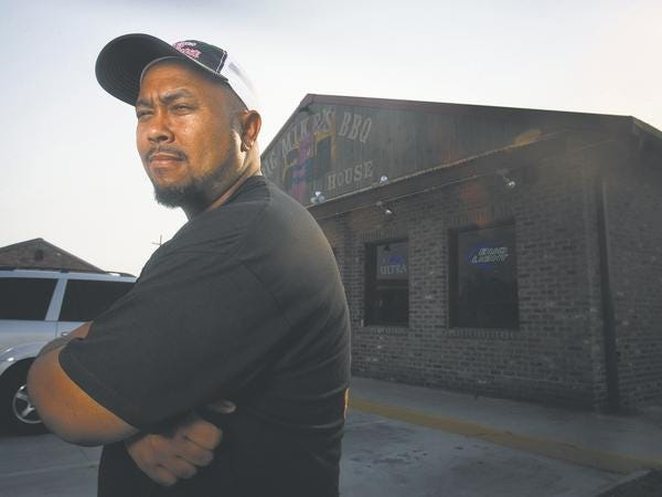 Mike Lewis stands in front of his Houma barbecue restaurant.