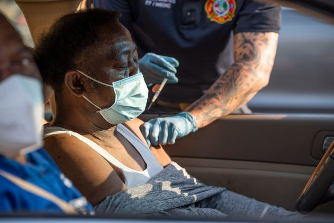 Lake County school custodian Willie Smith gets a COVID-19 vaccine recently in Mount Dora. [Cindy Peterson/Correspondent]