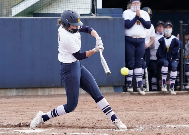 Siena Heights second baseman Maddie Herrera drives a ball for a base hit during Thursday's WHAC doubleheader against Aquinas at Christensen Memorial Field in Adrian.