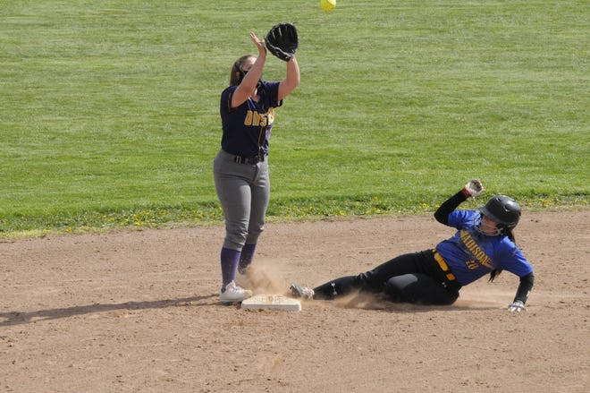 Madison's Annie McDade (18) slides in safely ahead of a throw to Onsted's Alex Osgood during Thursday's doubleheader at Onsted High School.