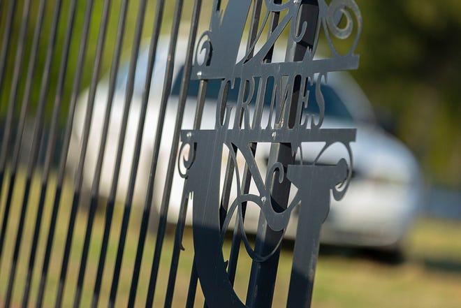 A patrol vehicle from the Giles County Sheriff's Department is stationed behind the open gate to the home James Grimes in Lynnville, Tenn., on Thursday, April 22, 2021.