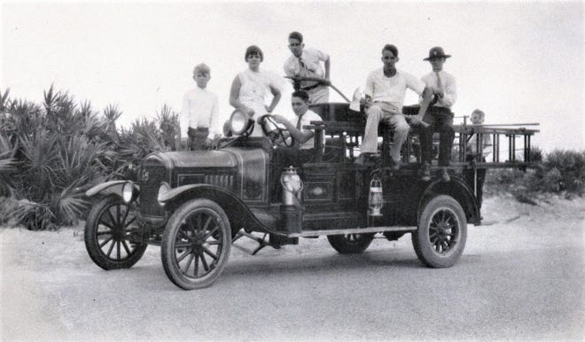 Junior volunteers pose on an early Flagler Beach fire truck in the 1920s. The Flagler Beach Fire Department was established in 1926, the year after Flagler Beach became an incorporated town.