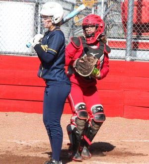 Coldwater's Karlie Knisely looks back a runner at third from her catchers spot versus Hastings on Thursday