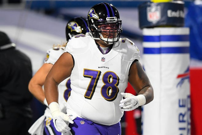 Baltimore Ravens offensive tackle Orlando Brown (78) jogs on the field prior to an AFC playoff game. The Kansas City Chiefs traded four draft picks for the All-Pro left tackle and two draft picks Friday.