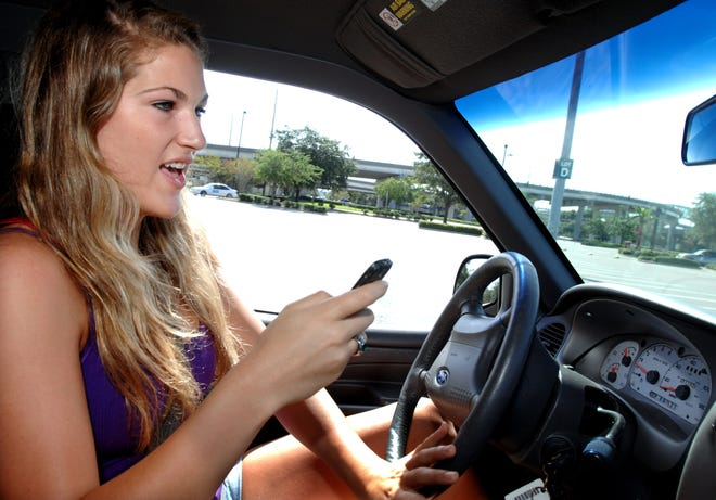 During a distracted driver training course sponsored by Allstate, a teen demonstrates how drivers can be distracted while trying to read a text message.