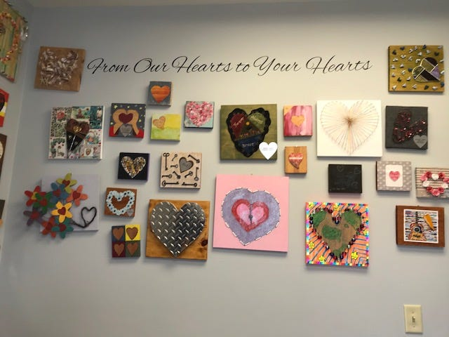 A wall of hearts welcomes visitors to Braveheart's Cambridge facility