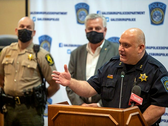 Galesburg police chief Russ Idle, right, answers a question during a City of Galesburg press conference regarding the formation of a new law enforcement task force to deal with violent crime in Galesburg on Friday, April 23, 2021 at City Hall.