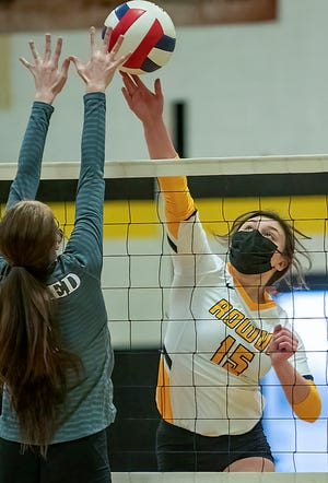 ROWVA junior Bella Ponce-Voss goes up high to tip the ball over the net during the Tigers' 2-0 loss to Williamsfield on Thursday, April 22, 2021 at Bob Meredith Gymnasium.