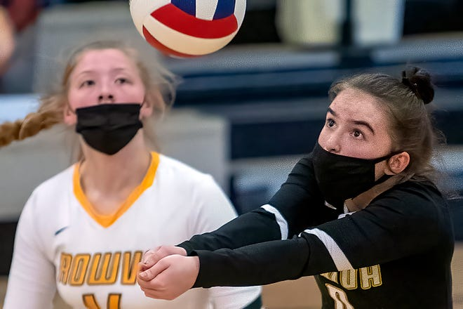 ROWVA sophomore Olivia Hopping, right, hits a bump shot as teammate Aki Cain looks on during the Tigers' 2-0 loss to Williamsfield on Thursday, April 22, 2021 at Bob Meredith Gymnasium.