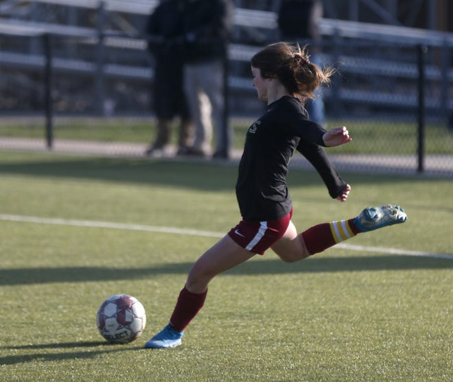Hays High's Maggie Robben attempts a free kick during a game last season.