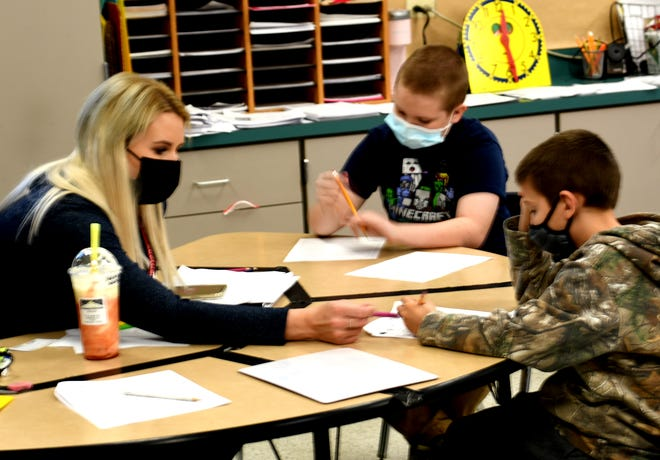 Terrell teacher Jessica Jakovac works one-on-one with Terrell students to sharpen math and reading comprehension skills.