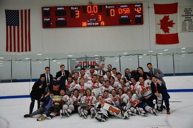 Hope College hockey team celebrates after claiming the national title