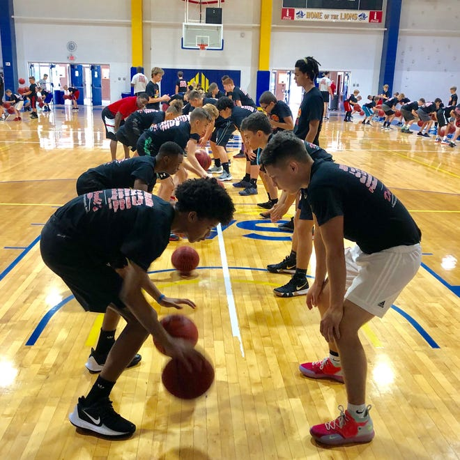 Campers work on dribbling at a past Crossfire Ministries camp at Mars Hill University.