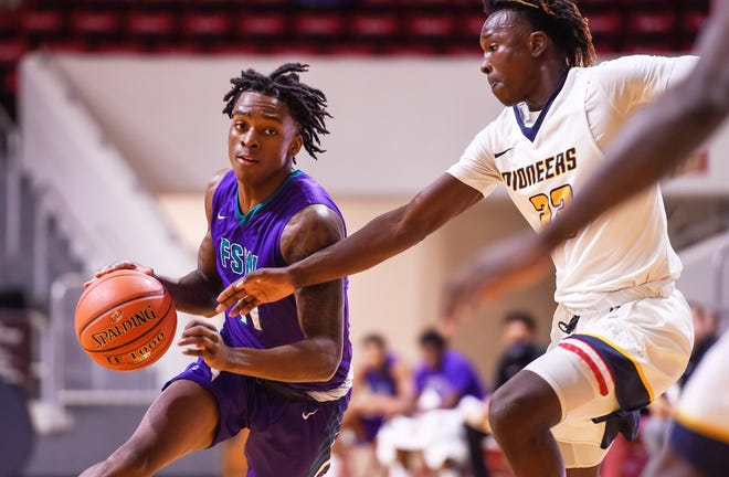 Terry Roberts, left, led Florida SouthWestern State College to an 18-5 mark and national ranking in 2020-21.