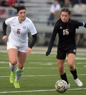 Newton freshman Isabel Sandoval, right, is challenged by McPherson senior Belle Alexander during play Thursday at Fischer Field. Newton plays Tuesday at Derby.