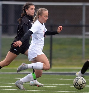 McPherson senior Kenzee Godwin, being chased down by Newton freshman Isabel Sandoval, scored three goals with two assists in a 10-0 win over the Railers. McPherson improves to 7-2, while Newton falls to 1-8.