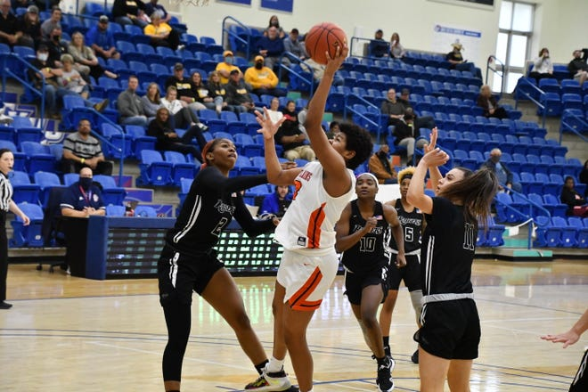 South Plains College center Debora Reis (13) battles through traffic during the Lady Texans' 63-54 loss to Northwest Florida State in Thursday's NJCAA Tournament quarterfinals at the Rip Griffin Center. Reis finished with 14 points and 12 rebounds.
