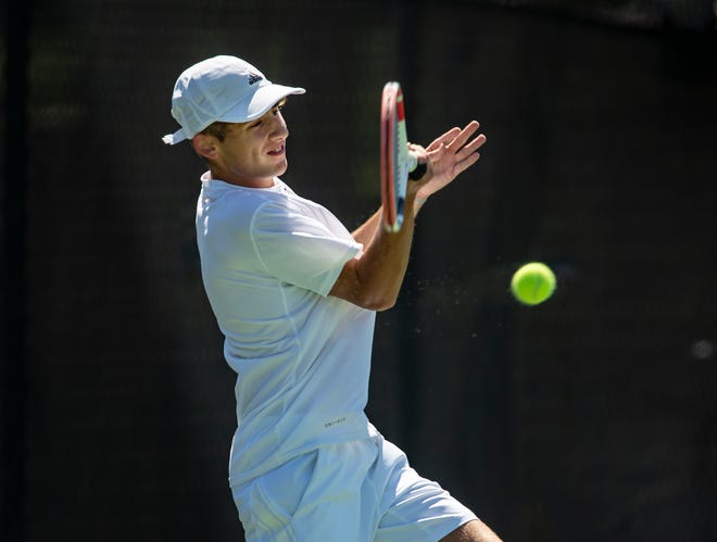 Lakeland's Christian Larsen returns a forehand shot while playing Dade City Pasco's Veer Bajaj in the 3A region finals at the Beerman Family Tennis Center in Lakeland.