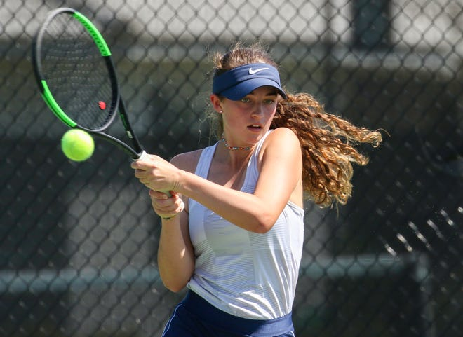 McKeel's Sarah Steeves hits a backhand during her match against Lemon Bay's Victoria Haranda at No. 5 singles on Thursday in the Class 2A region finals at the Kelly Recreational Complex. Steeves won, 6-2, 6-0.