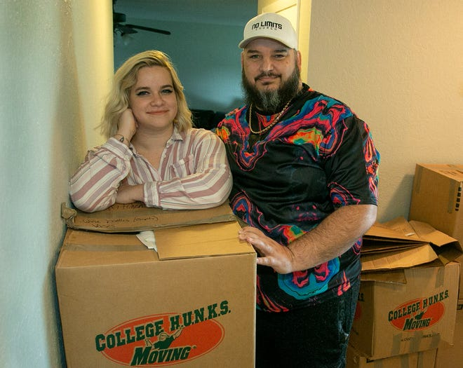 Frank Ammons and his wife, Mary, are surrounded by unpacked moving boxes in a hallway of their new home in South Lakeland on Friday. The family, formerly of Plant City, moved into the home two weeks ago.