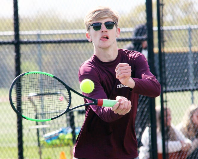 Osage's Drew Elley returns a ball in a match against Camdenton on April 21 in Osage Beach.