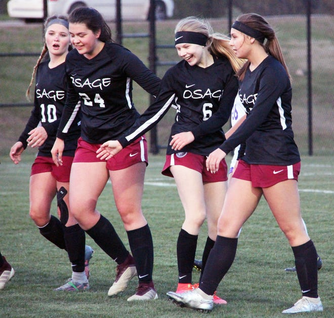 Osage players celebrate a goal by freshman Grace Larson (6) in a game against Camdenton on April 21 in Osage Beach.