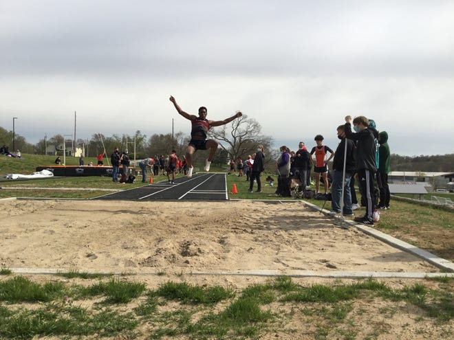 Shown is Lansing senior Malik Benson competing in the long jump Thursday at the Bonner Springs Invitational.