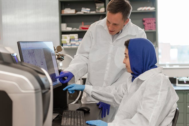 Thomas Gaborski, associate professor of biomedical engineering, works with Zahra Allahyari, a graduate research assistant and Ph.D. candidate in the Rochester Institute of Technology microsystems engineering program.