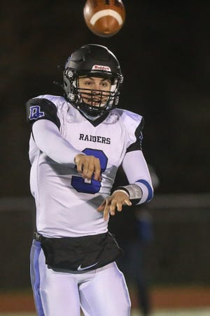 Dover-Sherborn junior quarterback Grady Russo makes a pass during a football game against Medfield at Medfield High School on Apr. 22, 2021.