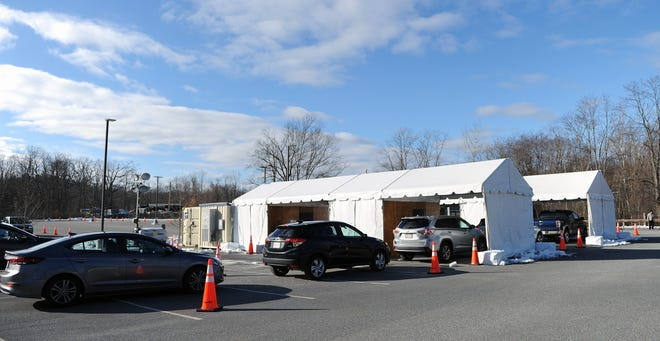A drive-through COVID-19 testing site at a Franklin Street parking lot in Framingham will move next month to Maple Street.