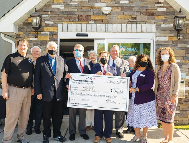Tennessee Housing Development Agency has awarded a $106,000 HOME Program grant to the Oak Ridge Housing Authority. In the front, from left, are Oak Ridge City Manager Mark Watson, Oak Ridge Housing Authority Commissioner Tom Beehan, Lt. Gov. Randy McNally, U.S. Rep. Chuck Fleischmann, state Rep. John Ragan, ORHA Executive Director Maria Catron, and Katie Moore, Tennessee Housing Development Agency industry and government affairs liaison. In the back row are ORHA Commissioner Jim Palmer, ORHA Board Chair Jean Lantrip, and ORHA Board Secretary Sharon Crane.