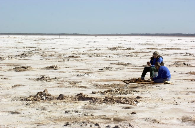Two people dig for crystals at the Salt Plains National Wildlife Refuge near Jet.
